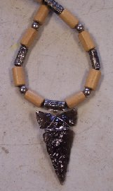 Click to see a larger picture of DS317 - Smoky Obsidian Arrowhead Wood and Metal Beaded Necklace